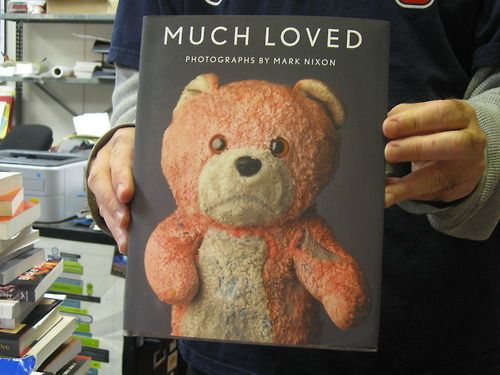 """Award-winning photographer Mark Nixon has created a trove of quirky and nostalgic portraits of teddy bears and other stuffed animals that have been lovingly abused after years of play. """"MuchLoved"""" collects 60 of these images along with their accompanying background tales."""