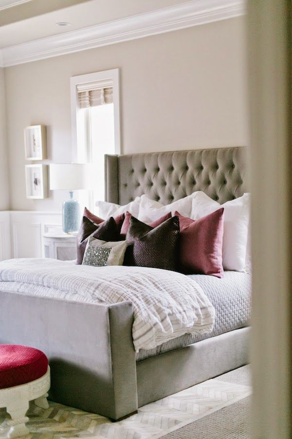 dream master bedroom%0A A close look at this relaxing master suite features an upholstered bed with  a gray  tufted headboard and an array of pillows in shades of plum