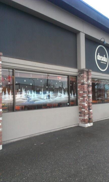 Beautiful handpainted winter scene in Decades front window. Chilliwack, BC