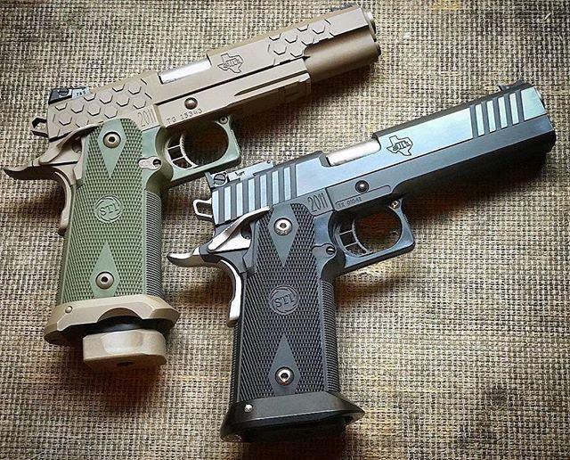 #Repost @pop_goes_the_glock ・・・ Two STI 2011s in 9mm. The same on paper but totally different in every detail. Which do you prefer? #pistols #sti @stiinternational #sti2011 #stihextac #stiedge #9mm #1911 #sti1911 #gunphotography #igmilitia #gunsofinstagram #guncollector #theperfectgun #separatedatbirth #mondaygunday #atx #madeintexas