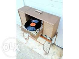 http://olx.pt/anuncio/gira-discos-vintage-zenith-stereophonic-IDu7iqb.html