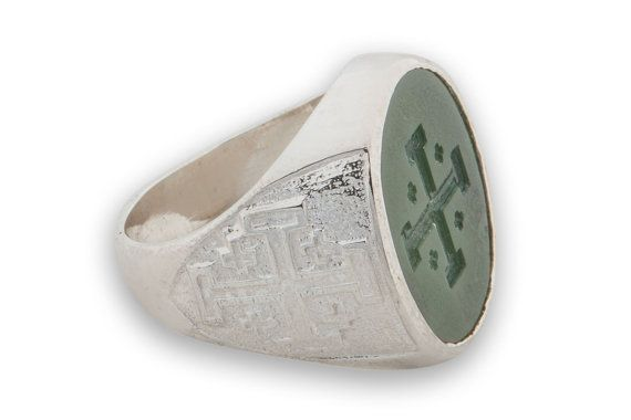 CROSS RING. Genuine High Quality Canada Jade Stone Intaglio. Ring Face Measures 22 x 18 mm (7/8 x 11/16 inch). A Heraldic ring. The Canada jade oval is mounted to a sterling silver chassis which features The Jerusalem Cross on both shoulders thus adding to the peaceful nature of this