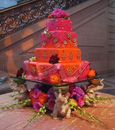 Three square orange and pink wedding cake ideas from Not Just Cheesecakes