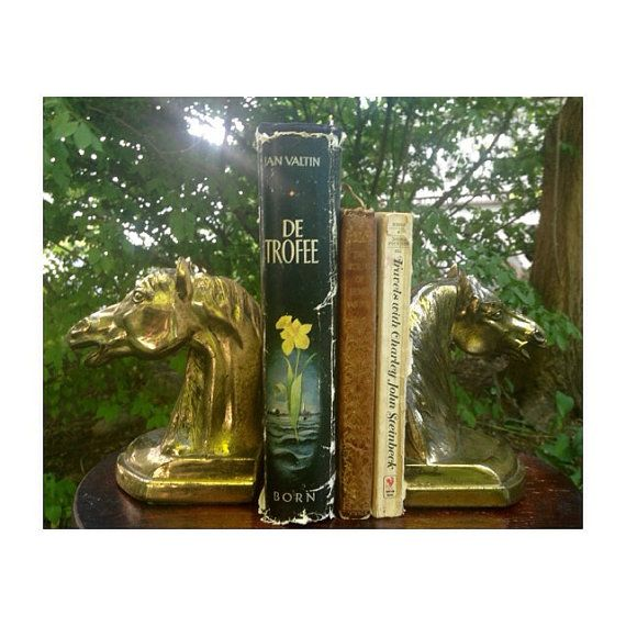 A Beautiful Classic Set of Bookends to compliment your space! This sturdy and heavy set of equestrian bookends, are in lovely vintage condition! There is some mild breakdown occurring in the plated brass, yet we believe this only adds to the charm! We have NOT polished these, yet we will provide this service upon request. With a green felted bottom, these bookends will complete your library or bookshelf with an eclectic style. Measurements are: 6 Tall x 5 Wide  Please send any questions our…