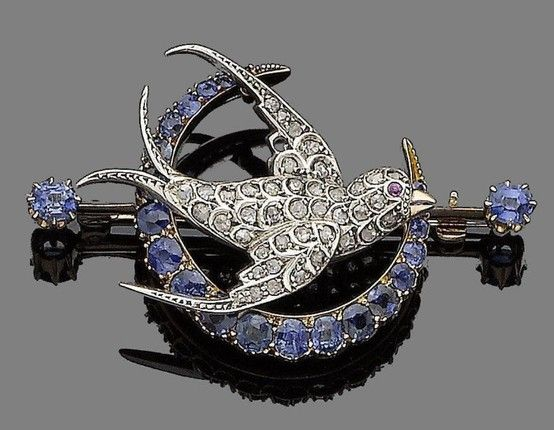 A 19th century diamond and sapphire brooch The swallow set throughout with rose-cut diamonds and a circular-cut pink sapphire eye, flying over a crescent set with cushion-shaped sapphires, to a bar terminating in similarly-shaped sapphires