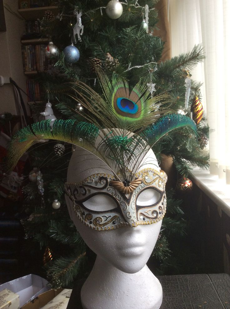 Mask with Peacock feathers