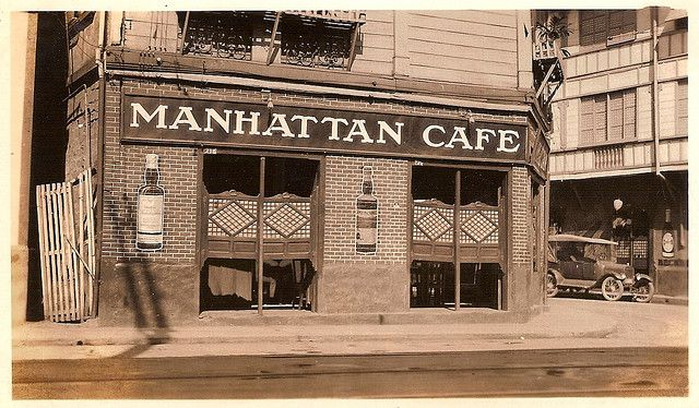 The Manhattan Cafe in Manila, photographed around 1920. Note the capiz shell saloon doors -- an interesting fusion of Filipino and American styles.