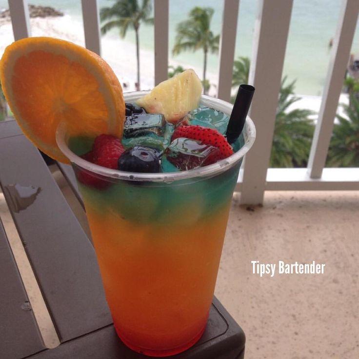 RAINBOW BREEZE Bottom Layer: 1 oz. (30ml) Grenadine Fill Glass with Ice Middle Layer: 1 oz. (30ml) Orange Juice 1 oz. (30ml) Pineapple Juice 1 oz. (30ml) Pineapple Rum 1 oz. (30ml) Banana Rum 1 oz. (30ml) Triple Sec Top Layer: 1 oz. (30ml) Mango Vodka 1/2 oz. (15ml) Blue Curacao