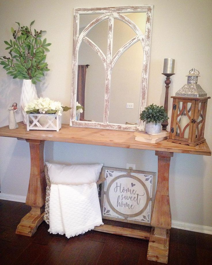 Farmhouse style console table entryway rustic distressed wood lantern olive branches