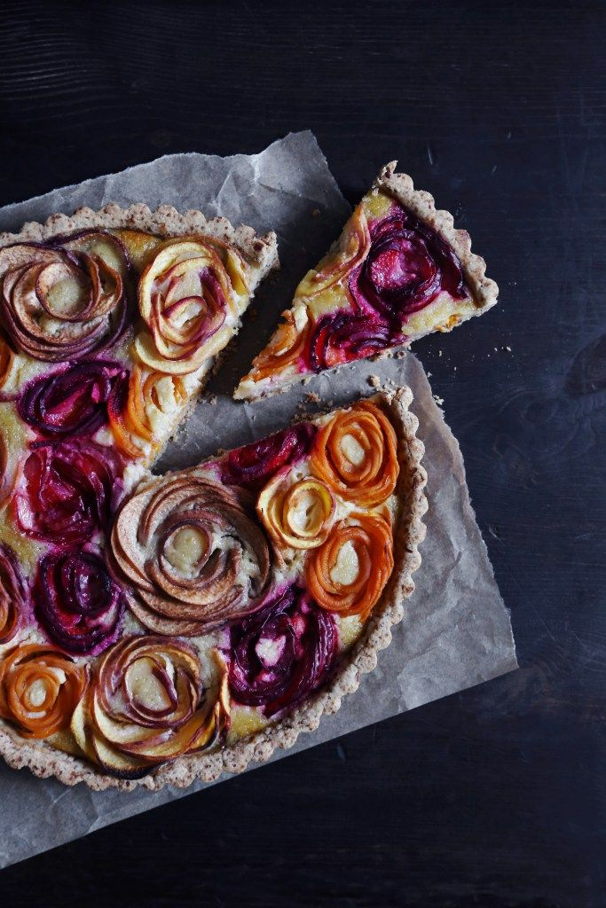 This tart has a gluten-free almond crust with a honey frangipane filling and topped with  stone fruit rosettes to make a beautiful and delicious dessert!