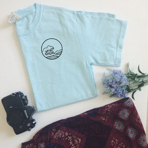 Featuring a handdrawn circular wave design, inspired by the famous Great Wave of Kanagawa painting, printed on a unisex Comfort Colors T.  Color may
