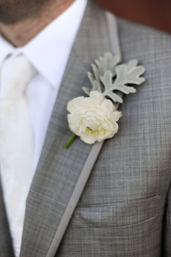 Grey suit, white shirt, ivory tie and boutonniere.