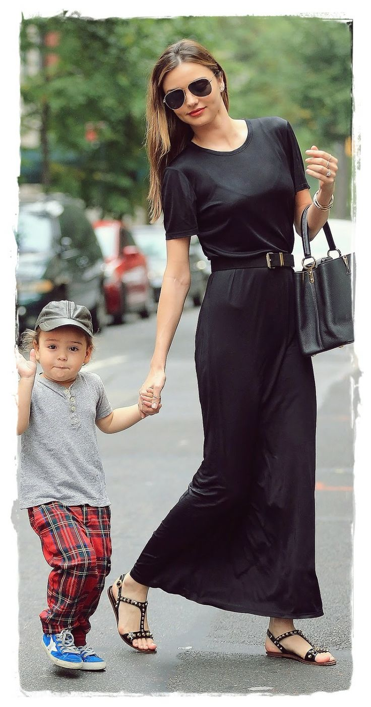 #Miranda #Kerr Street Style Snapshot - Invest In A Black Maxi | Miranda Kerr Street Style Snapshot - Invest In A Black Maxi When in doubt, always pull on a black maxi. Miranda dresses it down with flat sandals and her signature aviator shades, adding polish with a structured bag and waist-cinching belt.