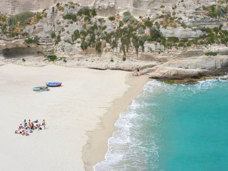 """Marasusa Beach is located in the pretty town of Tropea, regarded widely as the jewel of Calabria and christened """"La Costa degli Dei""""—the Coast of the Gods. It's easy to see why the gods would approve: Marasusa boasts scenic cliffs, pristine white sands, and calm, clear aquamarine waters."""