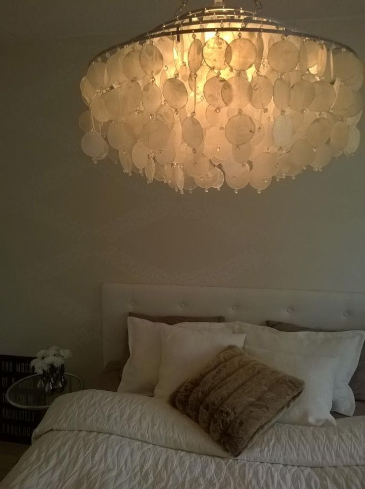 White bedroom, shell pendant lamp