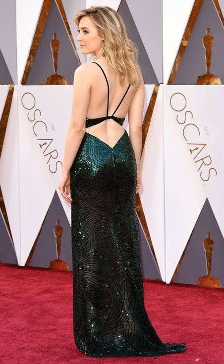 Saoirse Ronan in a custom Calvin Klein Collection sequin gown with coordinating Chopard emerald jewels