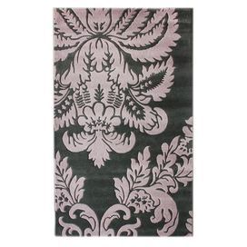 Hand-carved wool rug with a damask motif.