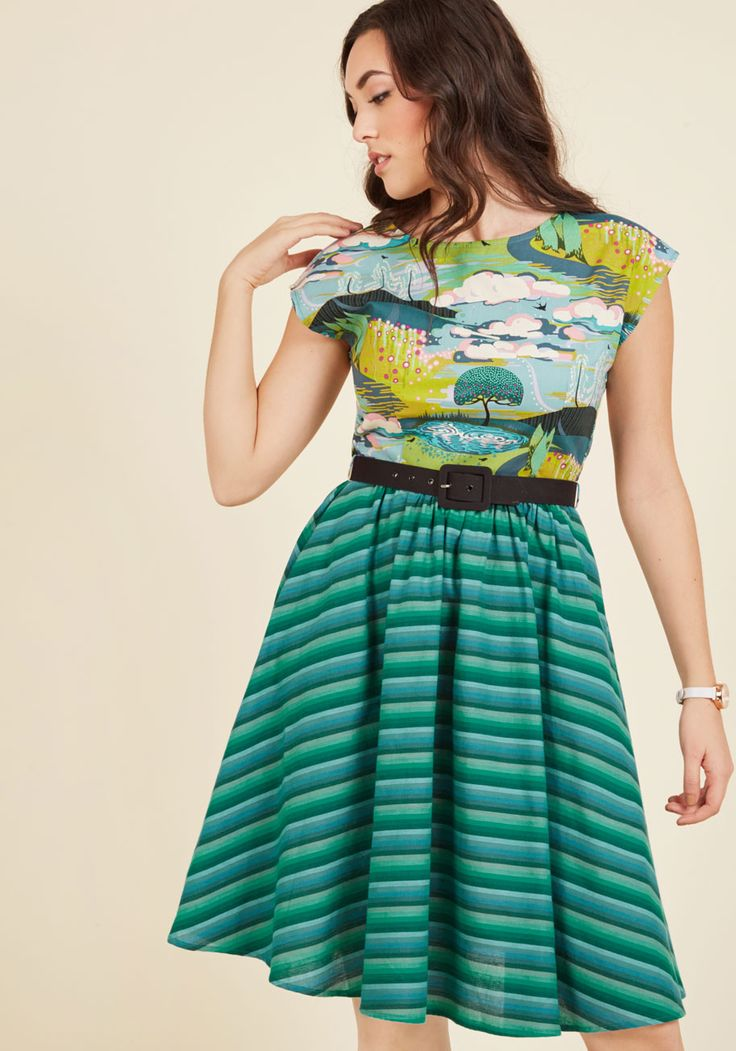 Upon donning this cotton dress and fastening its black belt, you're prepped for a day of aesthetic adventure! Colorful clouds, swirling willows, chartreuse meadows, and rippling ponds detail the cap-sleeved bodice of this pocketed frock, as its cool-toned stripes round out its landscape, leaving you feeling imaginative open-minded.