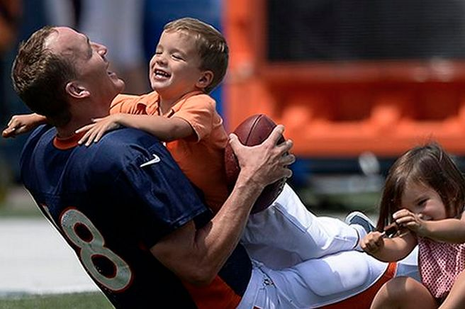 Peyton Manning Gets Tackled by His Son at Training Camp -- say it ain't so! up until this picture, i haven't seen his daughter -- but plenty of shots of him with his son at all kinds of events ... so, yeah, dad!!