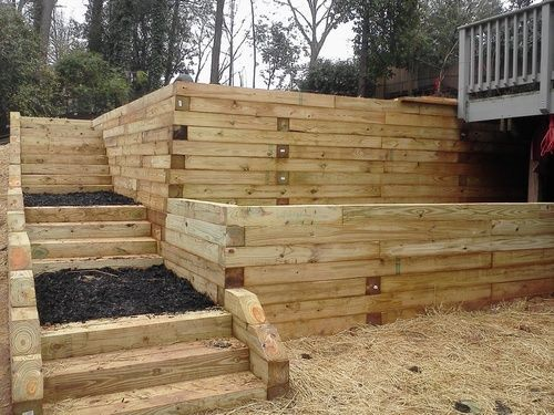 Timber retaining wall 9 Foot tall with steps   | DIY