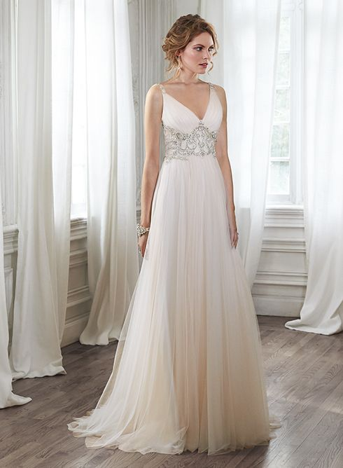 Stunning tulle sheath wedding dress with plunging neckline and sparkling Swarovski crystal waist, Phyllis by Maggie Sottero.
