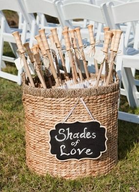 Adorable umbrellas for blocking the sun during the ceremony! #summerweddings