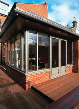 Glazed extension - lose the red brick under render.