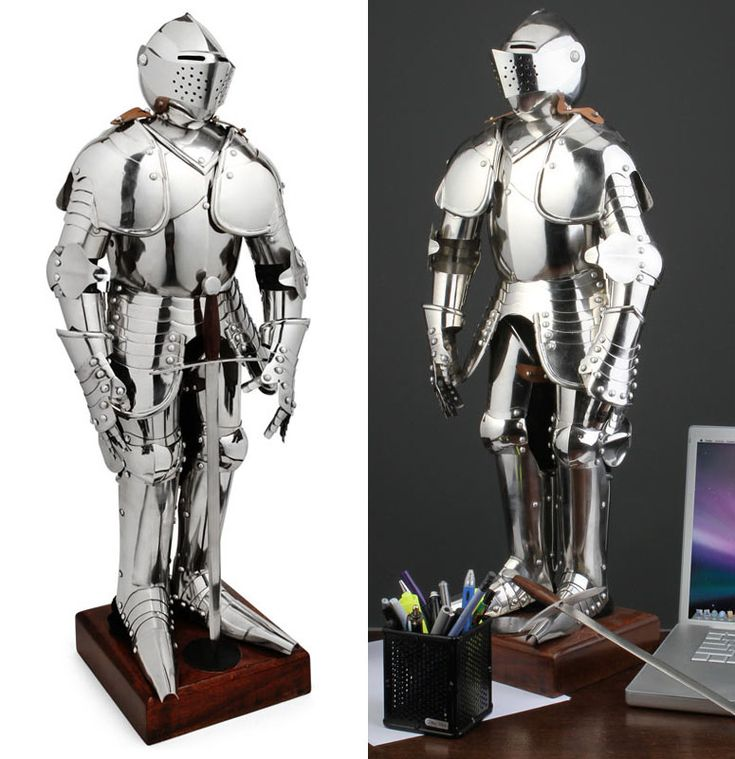 This Knight's medieval armor looks just like the real thing, except it's a miniature replica that stands only 25 inches tall.