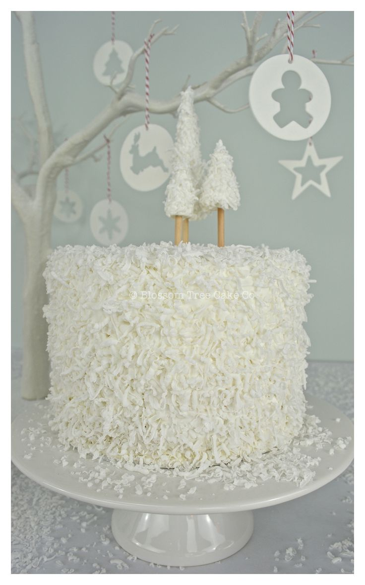 Our delicious range of Christmas cakes... moist brandy soaked fruit cakes, laden with Christmas spices...topped with white marzipan and 'snow effect' icing with handmade Christmas trees or fondant icing and reindeer decoration... http://www.blossomtreecakeco.co.uk/about-us/news.html