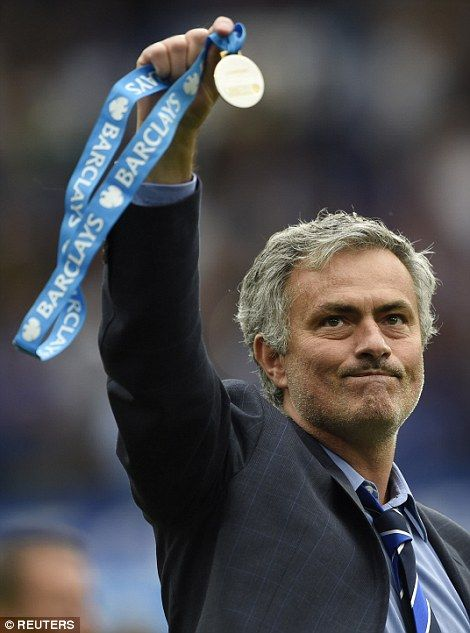 Chelsea manager Jose Mourinho celebrates with his medal