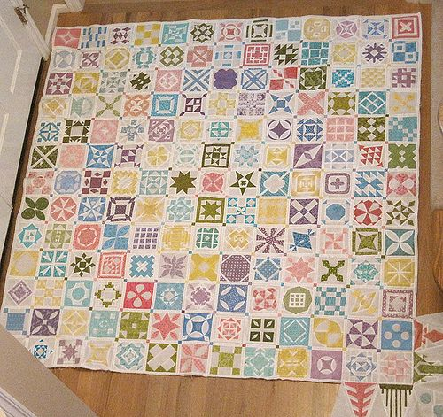 this blog gives a tutorial for each block on this quilt - some of hte little blocks have up to 40 pieces!  Someday I would love to make a baby jane quilt!!