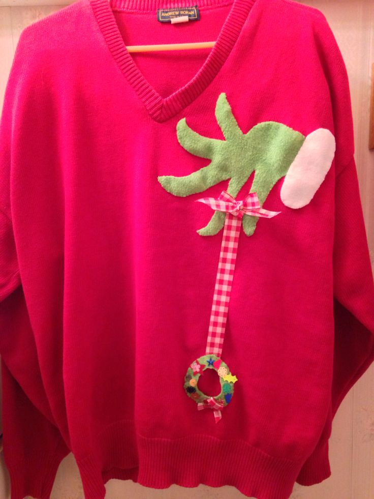 """My version (thrift store sweater, fleece, ribbon and a little sewing) for my son's ugly sweater party. When he was done with it, my nephew """"won"""" it on Christmas Day!"""