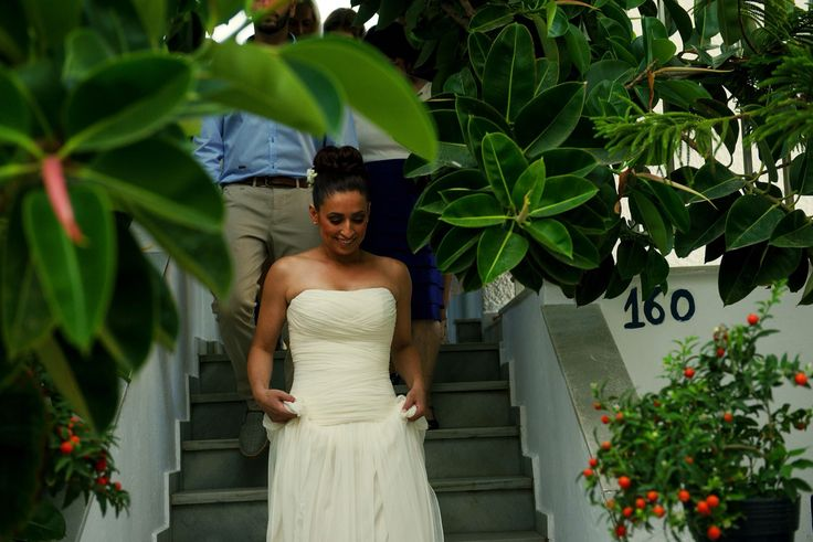 Paros island was the place Irene Kontothanou chose to get marrried. Wearing wedding dress by Alexia Kirmitsi. Strapless low waist corseted bodice with asymmetrical drapes and structures giving the right effect on a silk mousseline fabric.