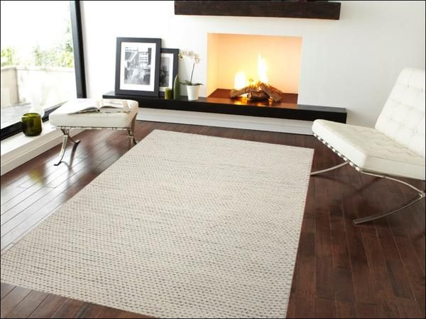 This super soft, plush wool rug is perfect for your living room: Hand Woven Felted Wool Braided Rug Ivory White