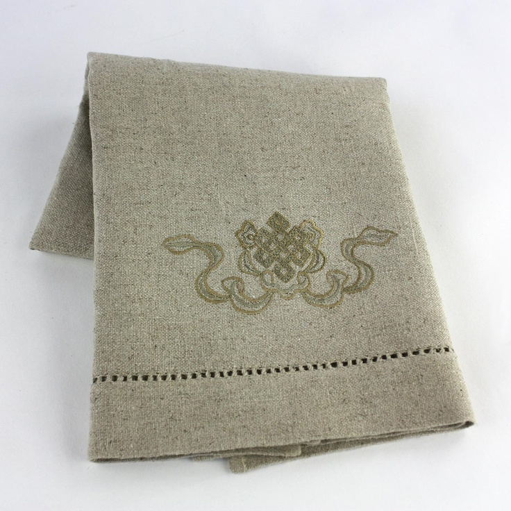Jute Guest Towel from Juniper Hearth, perfect for the guest bathroom. Beautiful linen-like weave in hand woven jute, with faggotted detail and fine finishing Intricate embroidery with a Tibetan 'Endless Knot' design in a golden thread. $39.