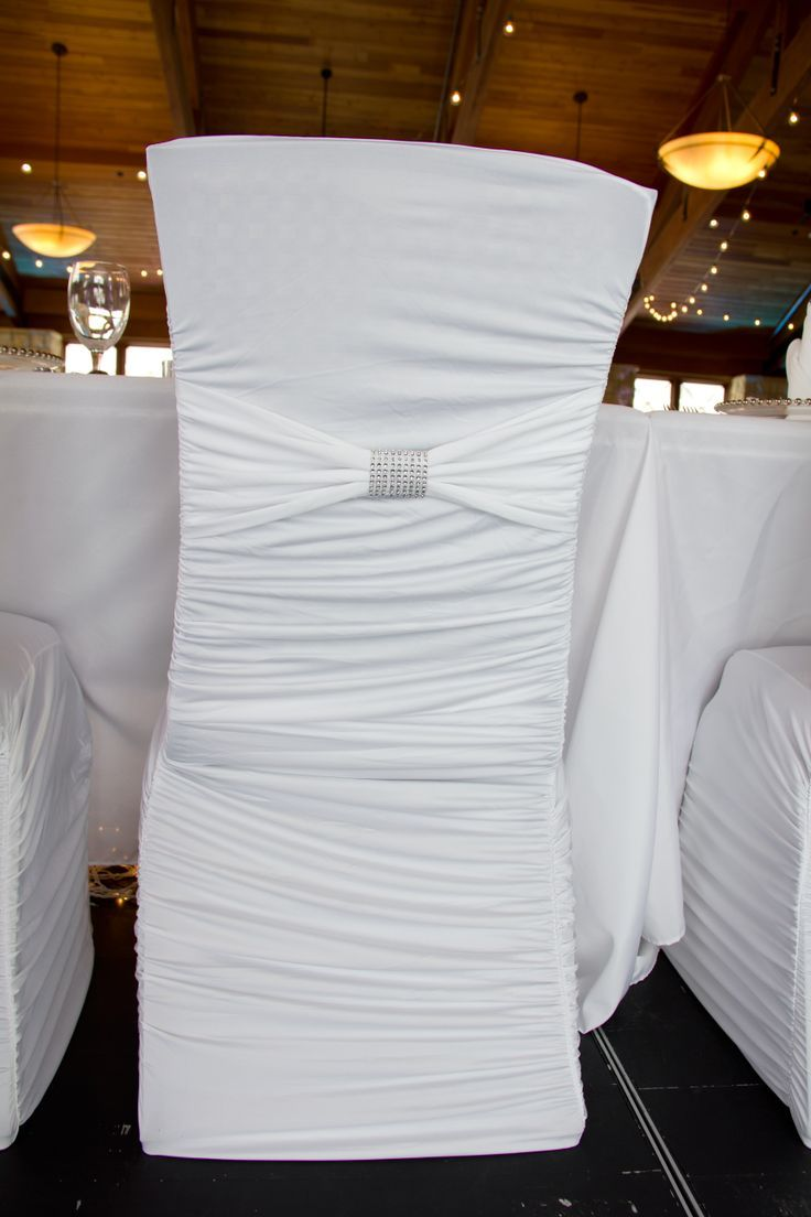 White ruched spandex chair cover with matching white band and rhinestone cuff. Perfect for winter weddings