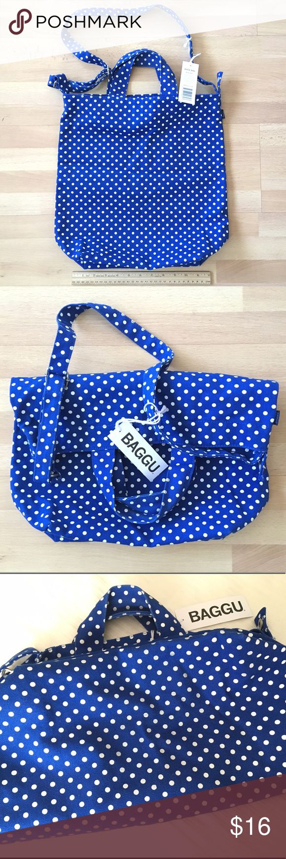 """Baggu The Duck Bag blue white dots canvas tote A perfect everyday tote in durable recycled cotton canvas duck. Two handles and 40"""" adjustable strap, to carry in hand or over shoulder. 16"""" x 10"""" x 5.5"""". Matte silver hardware. Durable taped seams. Snap inner pocket. 100% 16 oz. recycled cotton canvas. 100% Authentic! Condition: Very good, just minor wear on dots from jeans otherwise, looks fab! Plenty of life left in this handy durable tote. Smoke free, pet free home. Retail $30. Check out my…"""