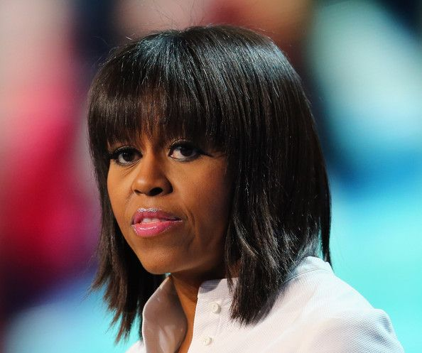 Michelle Obama Medium Straight Cut with Bangs     Michelle Obama debuted these brand-new blunt-cut bangs on her 49th birthday—right before the 2013 Presidential Inauguration.       Michelle Obama Lipgloss     Michelle Obama sported glossy lips at the Kid's Inaugural Concert.