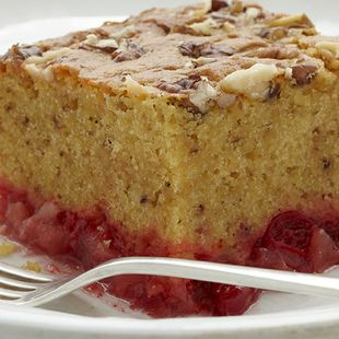 Dump Cake: A medley of Duncan Hines Classic Yellow Cake, pineapple, sweet cherries, and crunchy pecan can be yours––simply 'dump' them in the pan and bake. This Dump Cake is easy, full of fruit and tastes delicious.