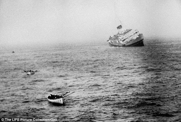 Drake recalled spending two hours praying and holding onto a post on the high side of the listing ship before she was led to the safety of a lifeboat. Pictured: the Italian liner Andrea Doria sinking in the Atlantic Ocean