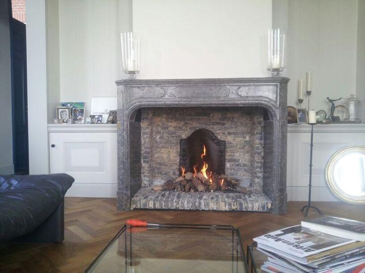 Antique burgundian grey Louis XIV fireplace