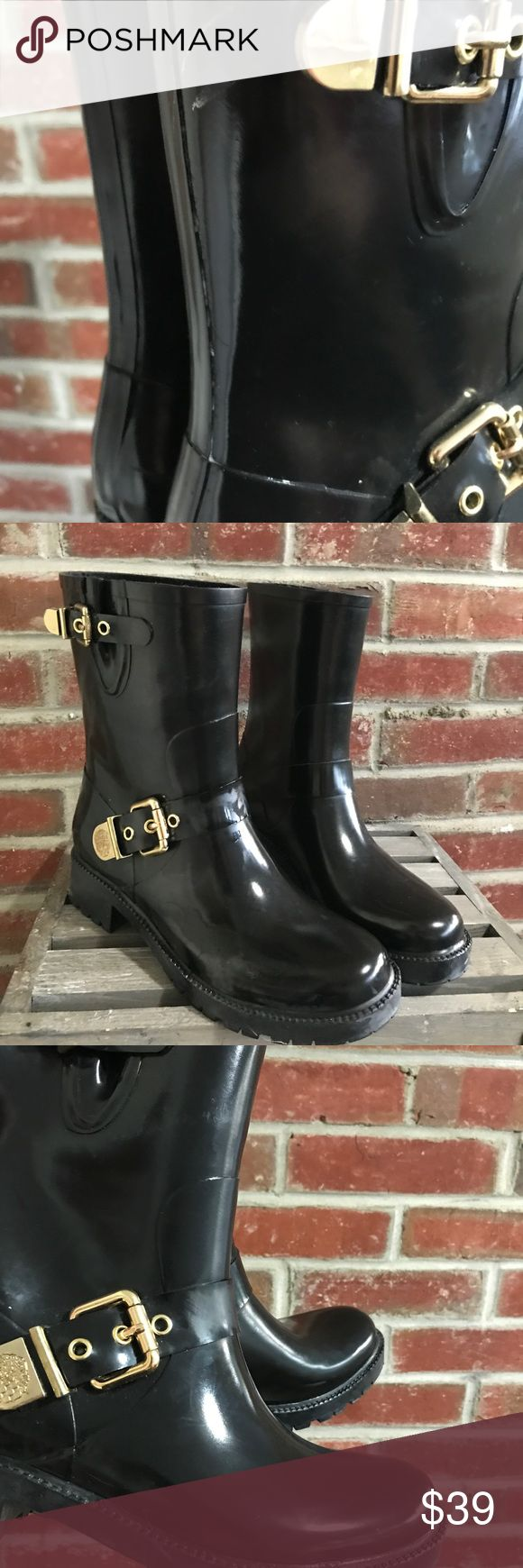 Vince Camuto Hinch black rubber rain boots 8 shoes Vince Camuto rain boots in size 8. The style is hinch. Worn a few times, good preowned condition. Please note that there is a mark on the back of one boot by the buckle, see last picture. Vince Camuto Shoes Winter & Rain Boots