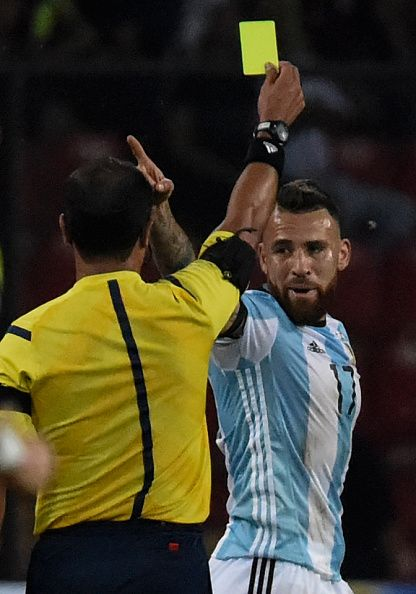 #WCQ2018 Ecuadorean referee Roddy Zambrano yellow cards Argentina's Nicolas Otamendi during the Russia 2018 World Cup football qualifier match between...