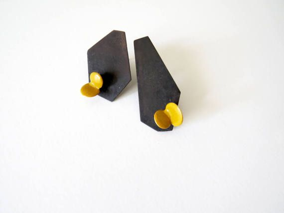 This pair of earrings is made from oxidized bases from brass and enameled polymer clay elements. In this series I have combined geometry with organic forms and in each pair earrings are coming in different shape. Long earring measurements: 4.8cm length, 2.0 cm width Small earring measurements: 3.5 cm length, 2.5 cm width  The part of the earrings that touches the skin is made from sterling silver. I would be more than willing to prepare other color combinations!  Please feel free to convo me…