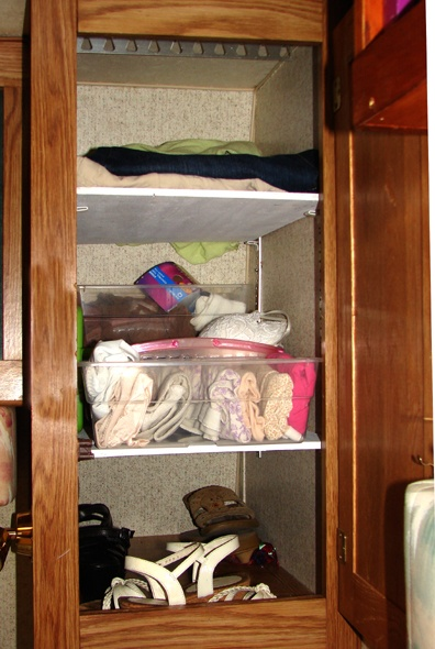 """Shelves make for more efficient rV space use but often storage solutions in an rV are in dire need of rethinking. The rV industry needs to hire more women for the design side of the job. It seems like industry can make it """"pretty"""" but they seem to have a real problem making it """"practical."""" Take cabinets as an example. Nifty """"oak"""" with filigree scroll work, shiny mirrors, and brass pulls, but open the door and inside is a big space that's often useless."""