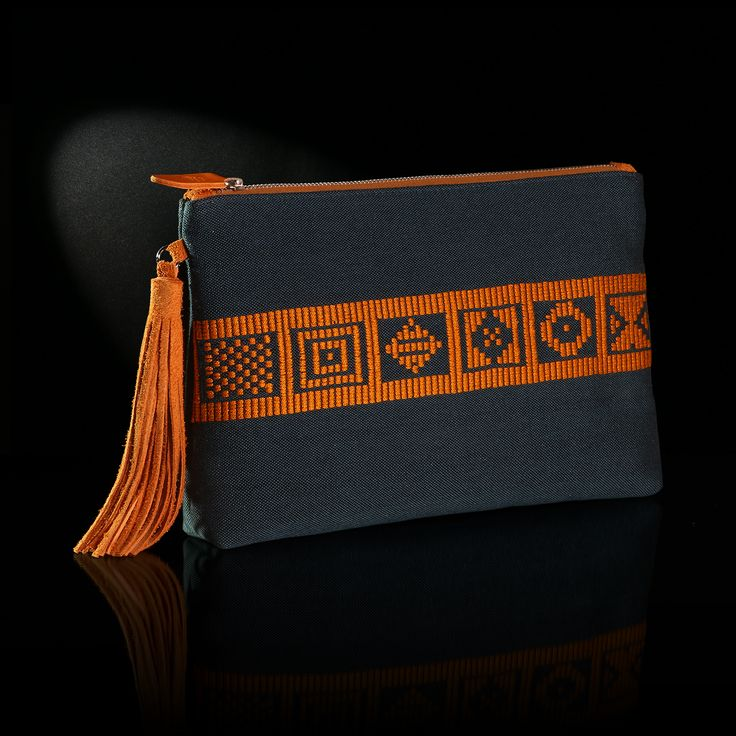 Τhe handmade woven envelope adorns patterns from Greek history and tradition. The background is in blue raf color and the embroidery in saffron color.