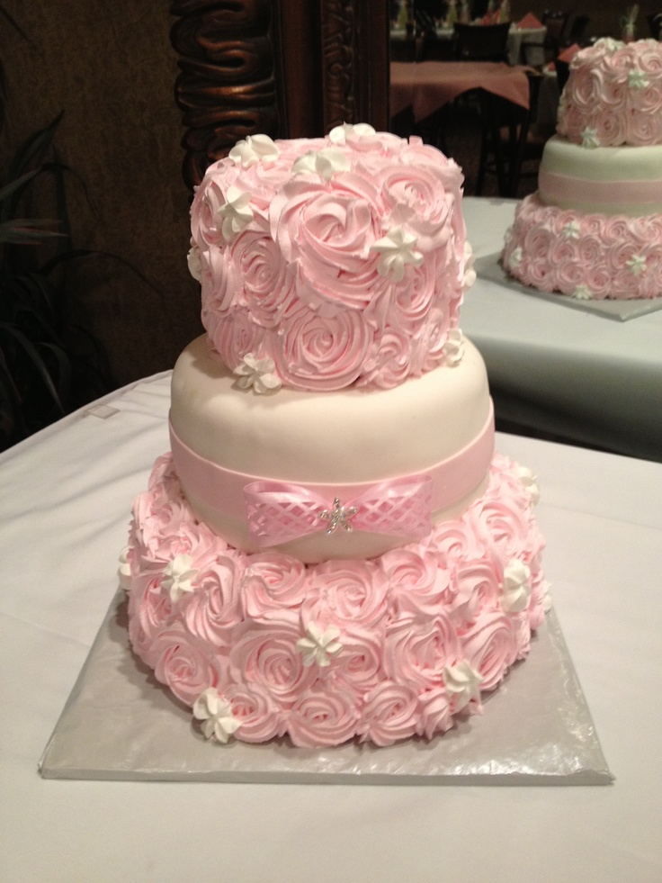 Three tiered pink and white rosette wedding cake by coleyscakes.com