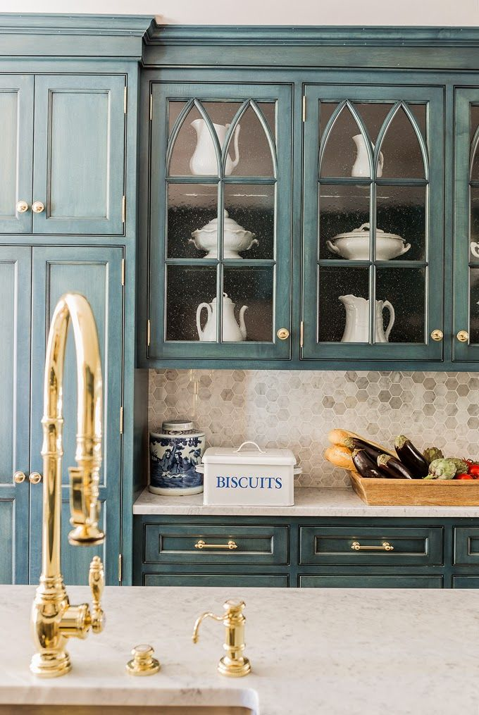 love the style of the glass cabinets and the back splash. looks good with the blue cabinets but Im not sure I would be that bold