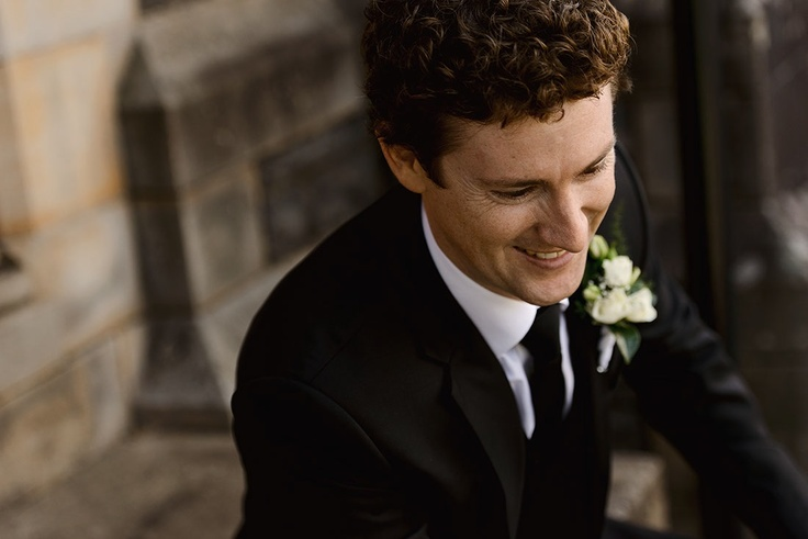 Groom in black wool cashmere suit.