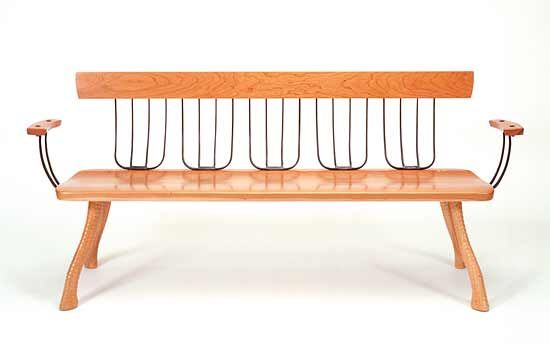 """Pitchfork Bench"" cherry bench with found pitchforks and axe handles by Brad Smith."